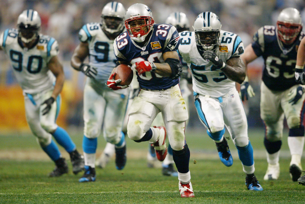 . Kevin Faulk #33 of the New England Patriots runs the ball against the Carolina Panthers during Super Bowl XXXVIII at Reliant Stadium on February 1, 2004 in Houston, Texas.  The Patriots defeated the Panthers 32-29.  (Photo by Andy Lyons/Getty Images)