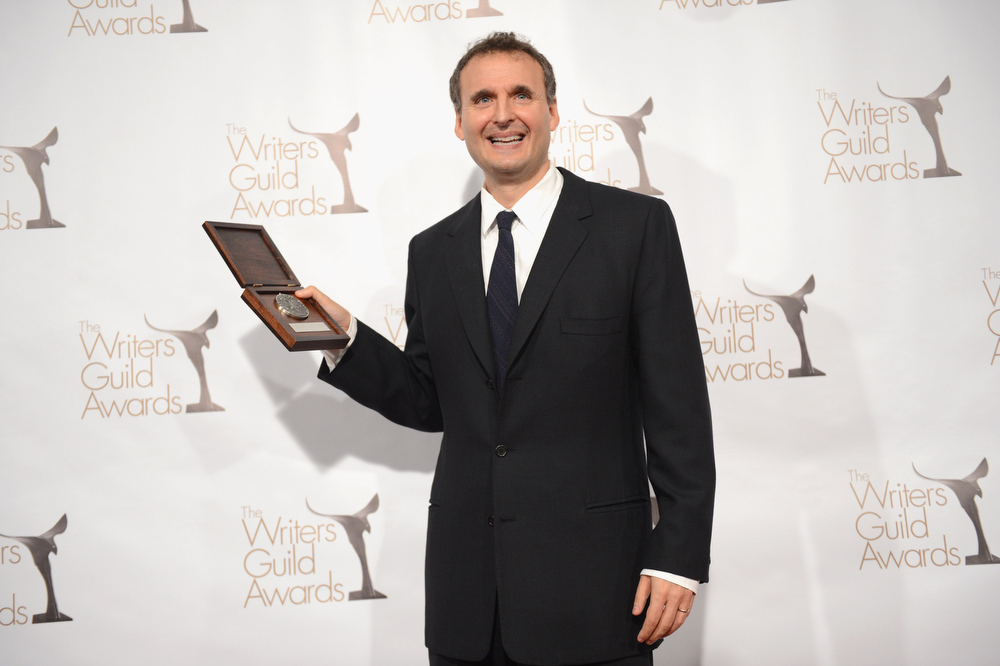 Description of . Writer Phil Rosenthal poses with the Writers Guild Valentines Davies Award in the press room during the 2013 WGAw Writers Guild Awards at JW Marriott Los Angeles at L.A. LIVE on February 17, 2013 in Los Angeles, California.  (Photo by Jason Kempin/Getty Images for WGAw)