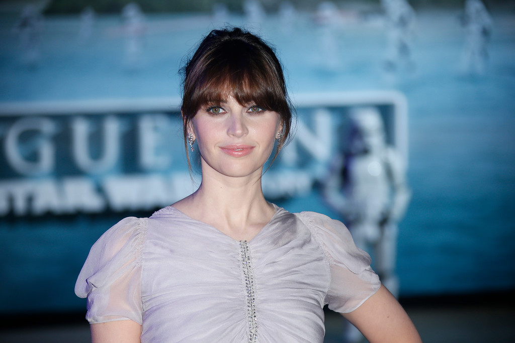 . Felicity Jones poses for photographers upon arrival at the Rogue One: A Star Wars premiere in London, Tuesday, Dec. 13, 2016. (Photo by Joel Ryan/Invision/AP)