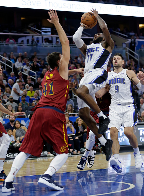 . Orlando Magic\'s Jonathon Simmons (17) gets off a shot over Cleveland Cavaliers\' Ante Zizic during the second half of an NBA preseason basketball game, Friday, Oct. 13, 2017, in Orlando, Fla. Cleveland won 113-106. (AP Photo/John Raoux)