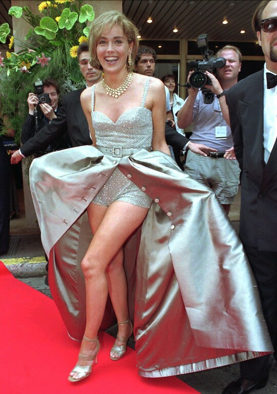 ". US movie star Sharon Stone shows her legs as she arrives at the world premiere screening of US director Douglas Keeve\'s film ""Unzipped\"" prior to the fundraising dinner for the American Foundation For AIDS in Cannes, French Riviera on Friday May 26, 1995, during the 48th International Cannes Film Festival.(AP PHOTO/Rhonda Birndorf)"