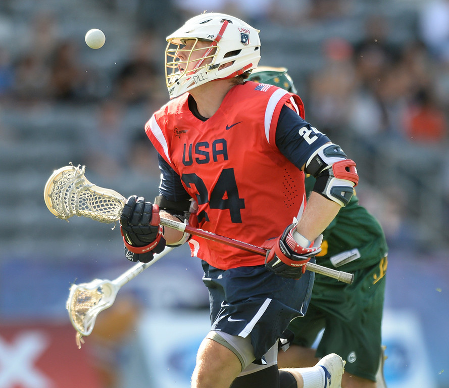 . COMMERCE CITY, CO - JULY 17: US midfielder Chris Eck (24) won a face-off with Australia midfielder Stephen Mortimer (13) in the second half. Team USA faced Australia in a FIL World Championship semifinal game Thursday night, July 17, 2014.  Photo by Karl Gehring/The Denver Post