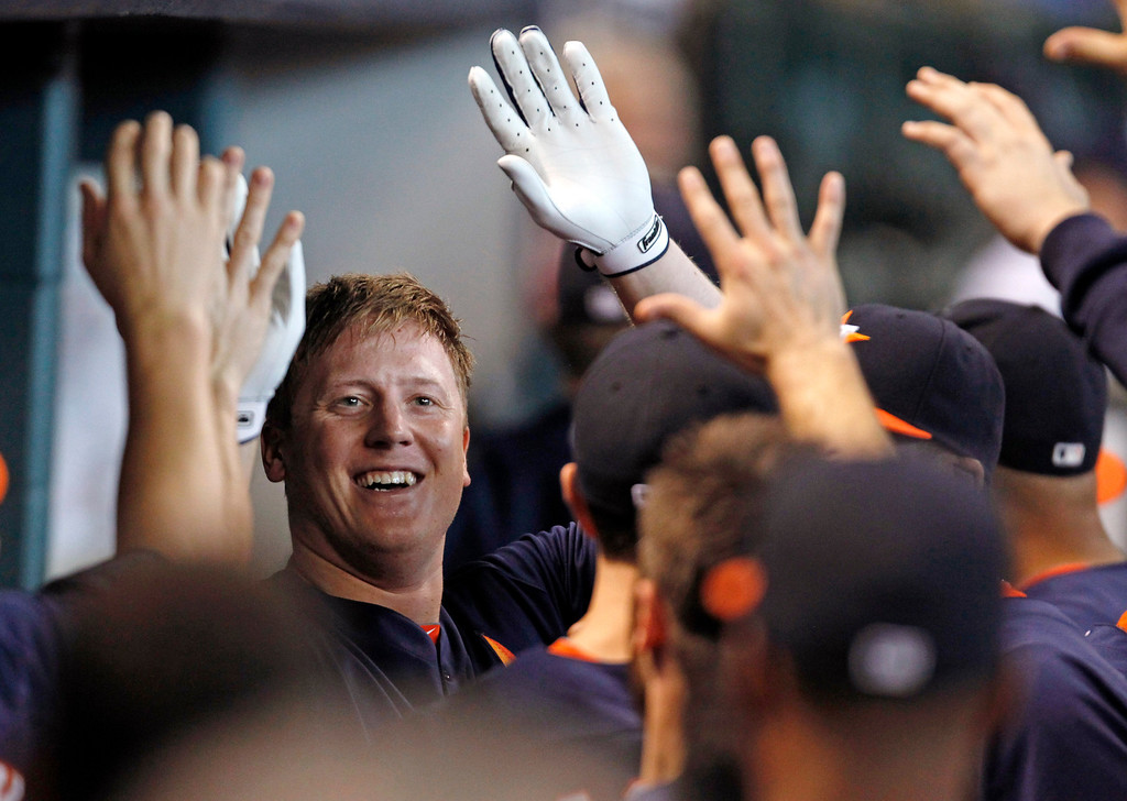 . Houston Astros\'s Marc Krauss celebrates with teammates in the dugout after hitting a solo home run in the second inning of a baseball game against the Los Angeles Angels Sunday, Sept. 15, 2013, at Minute Maid Park in Houston. (AP Photo/Eric Christian Smith)