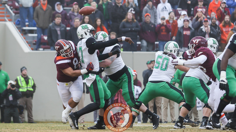 Virginia Tech DT Ricky Walker strip-sacks Marshall QB Isaiah Green on the first play of the game. (Mark Umansky/TheKeyPlay.com)