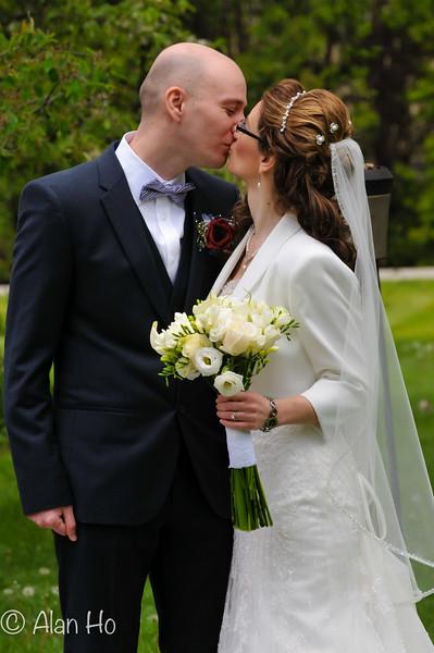 bride and groom kissing out door.jpg