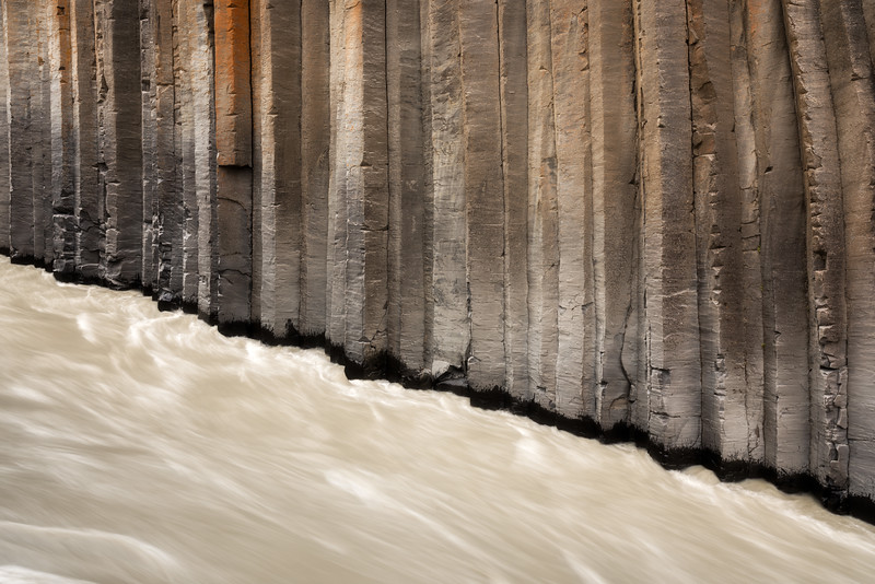 Studlagil canyon abstract landscape photography iceland basalt river.jpg