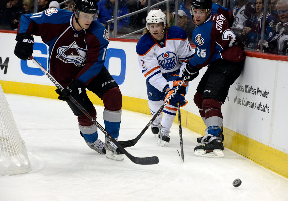 . DENVER, CO. - FEBRUARY 2ND: Jamie McGinn, left, and teammate Paul Stastny, right, pursue the puck against the defense of Jeff Petry, Edmonton Oilers, during the first period of play at the Pepsi Center in Denver Colorado, February 2nd, 2013.  (Photo By Andy Cross / The Denver Post)