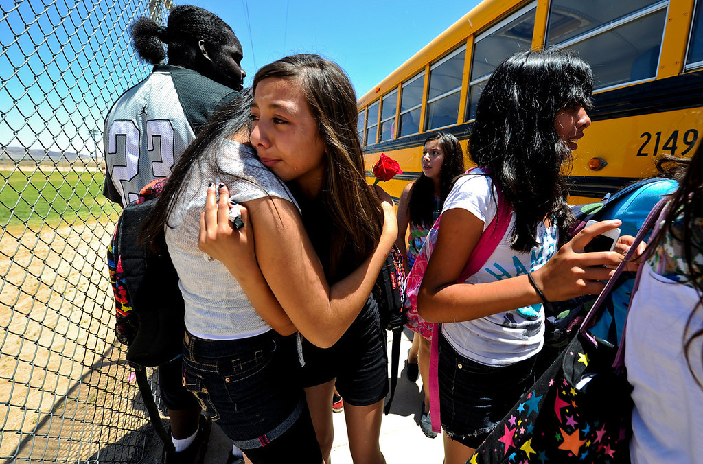 . Hinkley student Brianna Varga cries as she says her final goodbye to a friend on the final day of school at Hinkley School in Hinkley, Calif. on Thursday, June 6, 2013. Hinkley School closed its doors for good at the end of the 2012-2013 school year. (Rachel Luna / San Bernardino Sun)