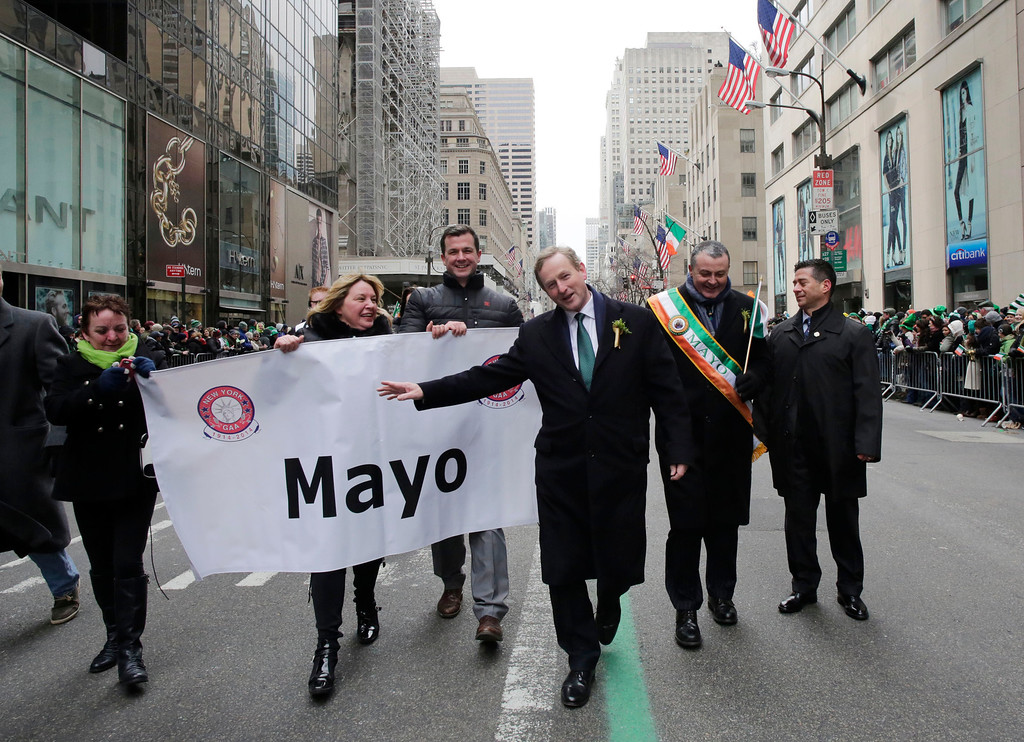 . Irish Prime Minister Enda Kenny, center,marches in the St. Patrick\'s Day parade, Monday, March 17, 2014 in New York. The city\'s parade stepped off Monday without Mayor Bill de Blasio marching along with the crowds of kilted Irish-Americans and bagpipers amid a dispute over whether participants can carry pro-gay signs. (AP Photo/Mark Lennihan)