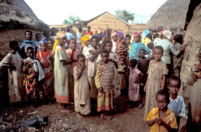 An African village in Sudan with many of the villagers outside their huts.  Photo by Jim Whitmer