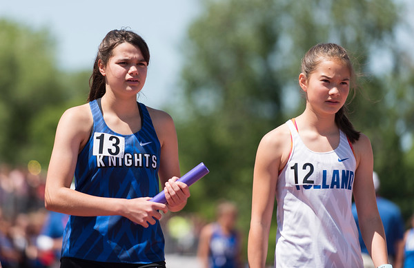 06/03/19 Wesley Bunnell | Staff The CIAC held their open track and field state open at Willow Brook Park on Monday afternoon. Southington's Jacqueline Izzo (13) before the start of the girls 4x800 meter relay.