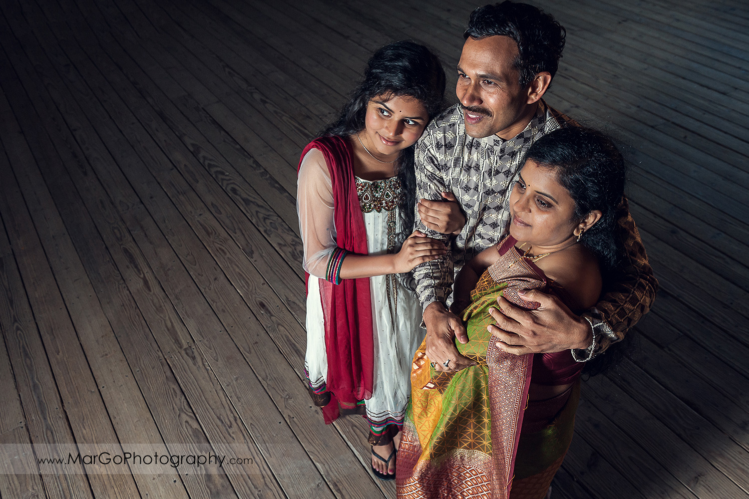Indian family looking left on the wood floor at Don Edwards Refuge in Fremont