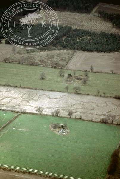Farmland west of Ravlunda church - with plantations, buildings and prehistoric remains (2 April, 1989). | LH.0517