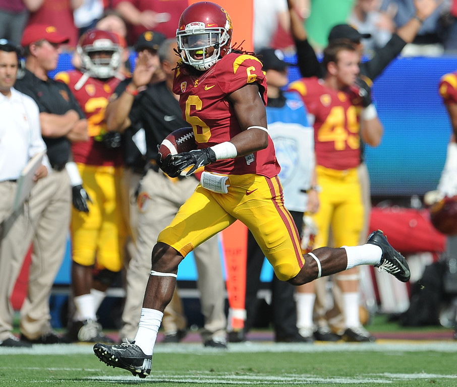 . Southern California safety Josh Shaw recovers a Utah fumble during the first half of an NCAA college football game in the Los Angeles Memorial Coliseum in Los Angeles, on Saturday, Oct. 26, 2013.  (Photo by Keith Birmingham/Pasadena Star-News)