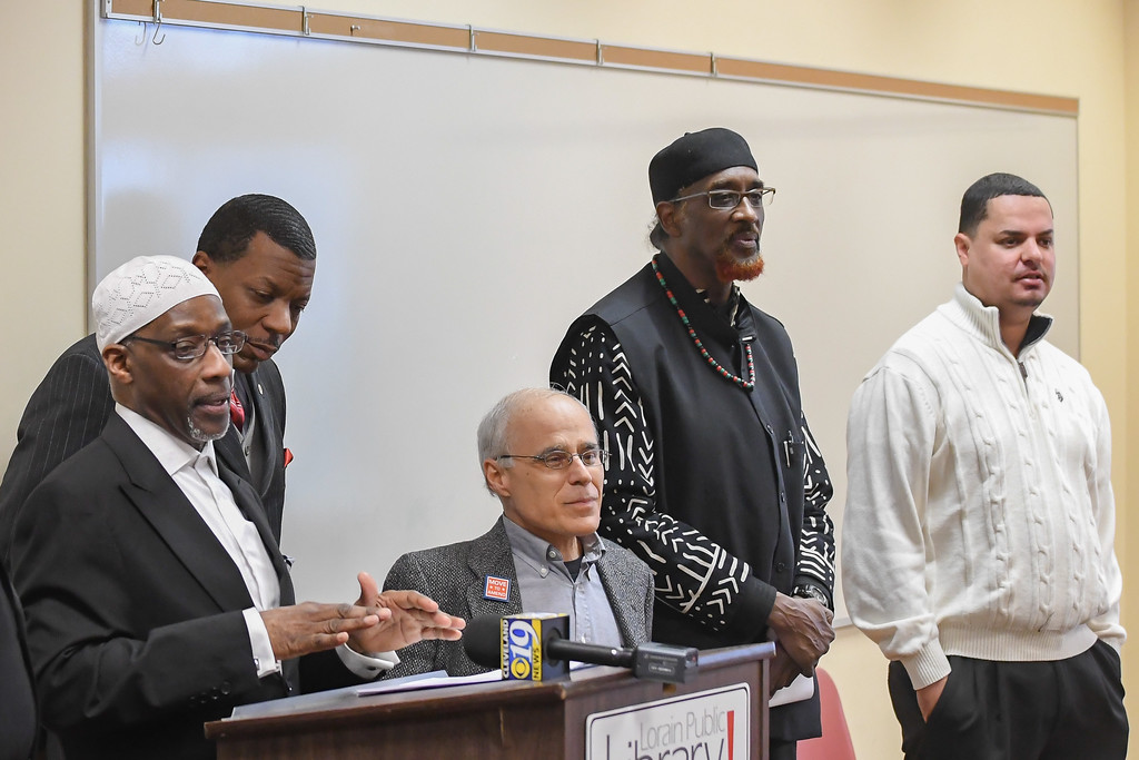 """. Imam Paul Hasan, spokesman for the International Council (pictured at the podium), addresses the public and media during a \""""national press conference\"""" held at the Lorain Public Library\'s South Lorain Branch, Jan. 16, 2017. Hasan, and other civic leaders of the community, came together to officially launch the International Council\'s campaign to denounce any potential legislation which would require Muslims residing in the United States to register with a national database. (Eric Bonzar/The Morning Journal)"""