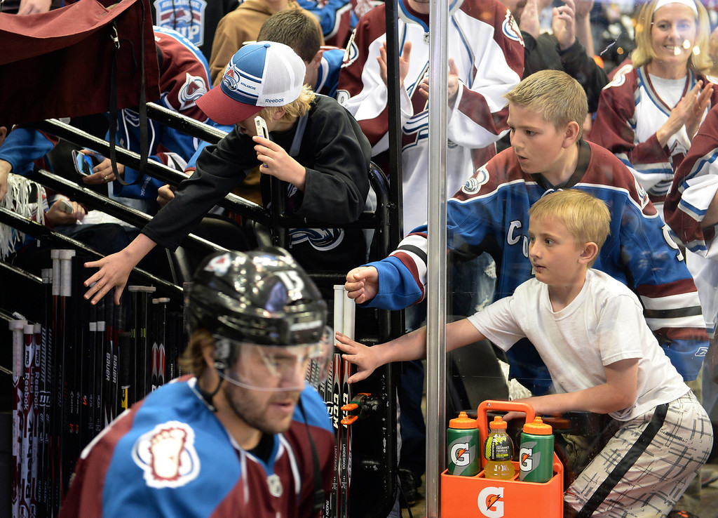 . DENVER, CO - APRIL 24: Colorado fans reached out to touch the players as they took the ice before the game Saturday night. The Colorado Avalanche hosted the Minnesota Wild in the fifth game of a playoff series Saturday night, April 26, 2014. (Photo by Karl Gehring/The Denver Post)