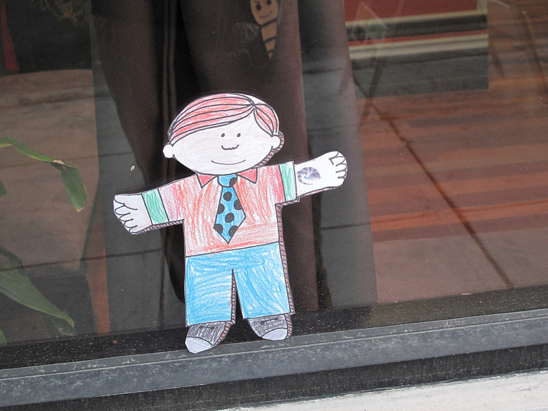 Flat Stanley checks out his new (temporary) tattoo.