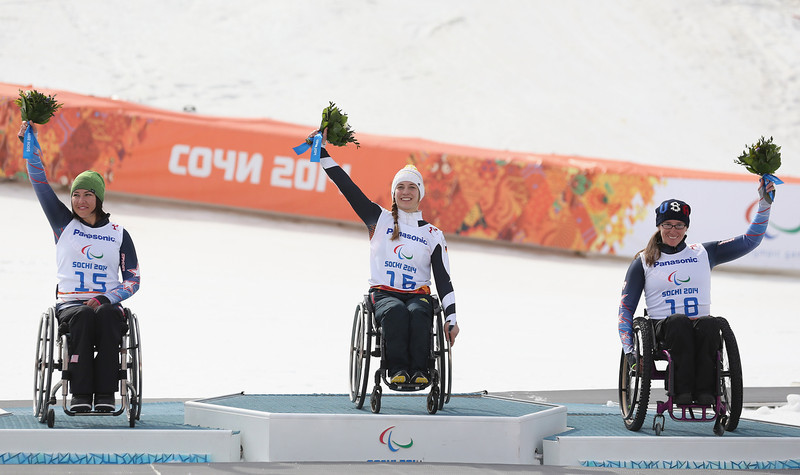 . (L to R)  Alana Nichols of United States celebrates winning Silver, Anna Schaffelhuber of Germany celebrates winning Gold and Laurie Stephens of United States celebrates winning Bronze after the Women\'s Downhill Standing during day one of Sochi 2014 Paralympic Winter Games at Rosa Khutor Alpine Center on March 8, 2014 in Sochi, Russia.  (Photo by Ian Walton/Getty Images)