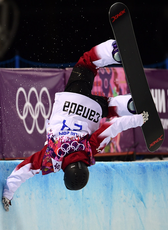 . Canada\'s Katie Tsuyuki competes in the Women\'s Snowboard Halfpipe Semifinals at the Rosa Khutor Extreme Park during the Sochi Winter Olympics on February 12, 2014.  AFP PHOTO / JAVIER SORIANO/AFP/Getty Images