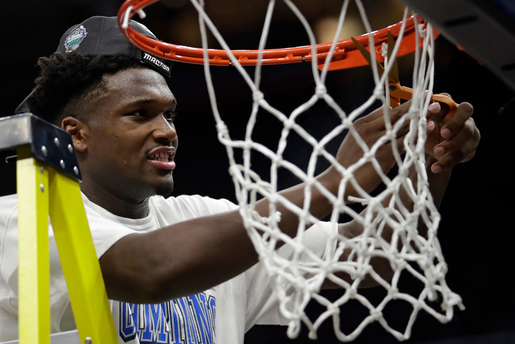 . Buffalo\'s Nick Perkins cuts the net after Buffalo defeated Toledo 76-66 during an NCAA college basketball championship game of the Mid-American Conference tournament, Saturday, March 10, 2018, in Cleveland. (AP Photo/Tony Dejak)