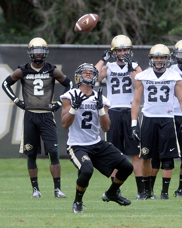 . University of Colorado\'s Devin Ross catches a punt during the second fall football practice on Wednesday, Aug. 7, at the CU practice fields. For more photos of practice go to www.dailycamera.com Jeremy Papasso/Camera