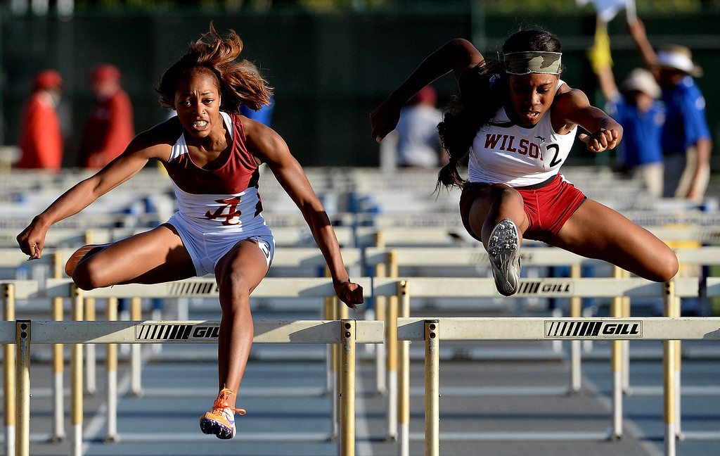 . Alemany\'s Skylin Harbin, left, and Long beach Wilson\'s Elijah McDonald competes in the 100 meter hurdles during the CIF-SS Masters Track and Field meet at Falcon Field on the campus of Cerritos College in Norwalk, Calif., on Friday, May 30, 2014.   (Keith Birmingham/Pasadena Star-News)