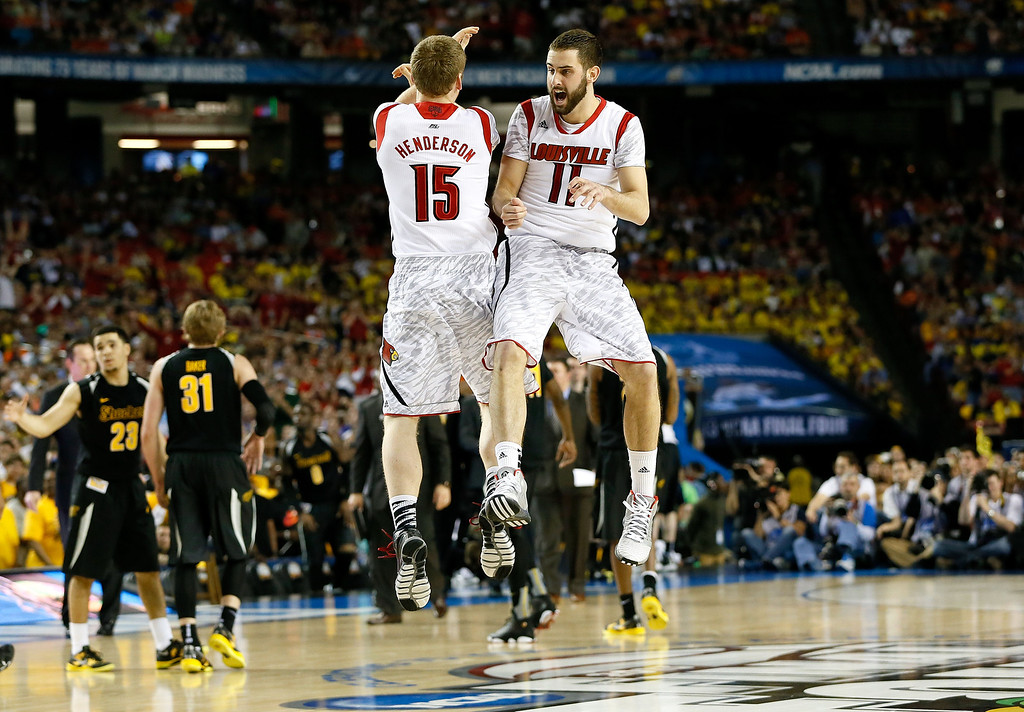 . ATLANTA, GA - APRIL 06:  Tim Henderson #15 and Luke Hancock #11 of the Louisville Cardinals celebrate late in the second half while taking on the Wichita State Shockers during the 2013 NCAA Men\'s Final Four Semifinal at the Georgia Dome on April 6, 2013 in Atlanta, Georgia.  (Photo by Kevin C. Cox/Getty Images)
