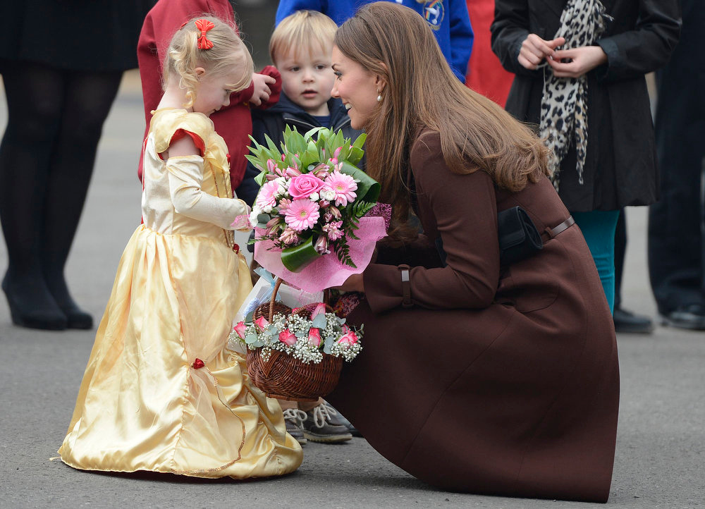 . Britain\'s Catherine, Duchess of Cambridge receives flowers from children during a visit to Peak Lane fire station in Grimsby, northern England March 5, 2013.    REUTERS/Nigel Roddis
