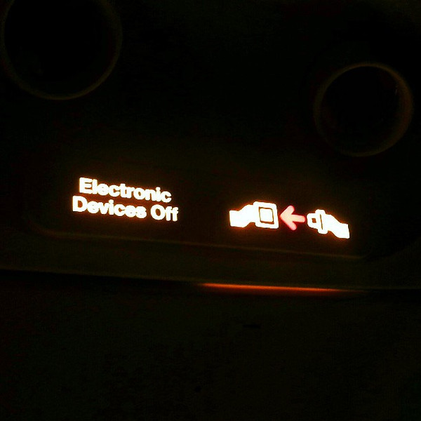 Two_surprises_on_my_flight_to_Sao_Paulo._1__electronics_sign_has_replaced_outdated_no_smoking_sign_2__I_have_free_wifi.jpg