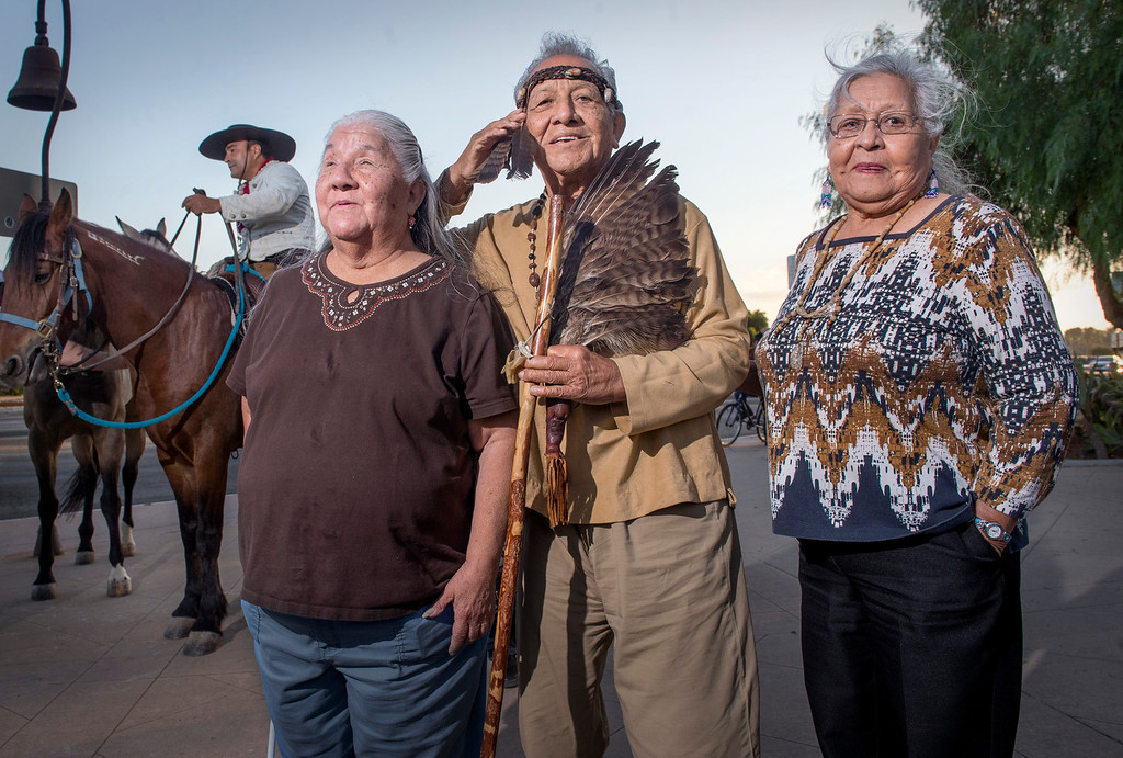 . Ernie Salas, chief of the Gabrieleño Band of Mission Indians/Kizh Nation,  greets the seven horseback enthusiasts at Mission San Gabriel as part of The California Mission Ride flanked by his sisters Jenny Swindall, left, and Lorraine Nava October 8, 2013.   (Staff photo by Leo Jarzomb/Pasadena Star-News)