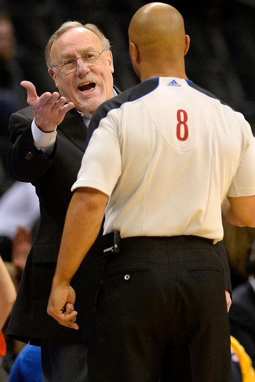 . Rick Adelman of the Minnesota Timberwolves argues with a referee against the Denver Nuggets during the second half . (Photo By AAron Ontiveroz/The Denver Post)