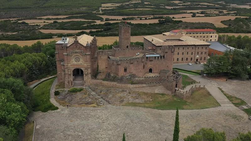 Available in 4k - Aerial drone clip showing the Castle of Xavier, Castillo de Javier, also called santuario de Javier near the Embalse de Yesa (Yesa Reservoir) in the Navarra Aragon region of the Spanish Pyrenees