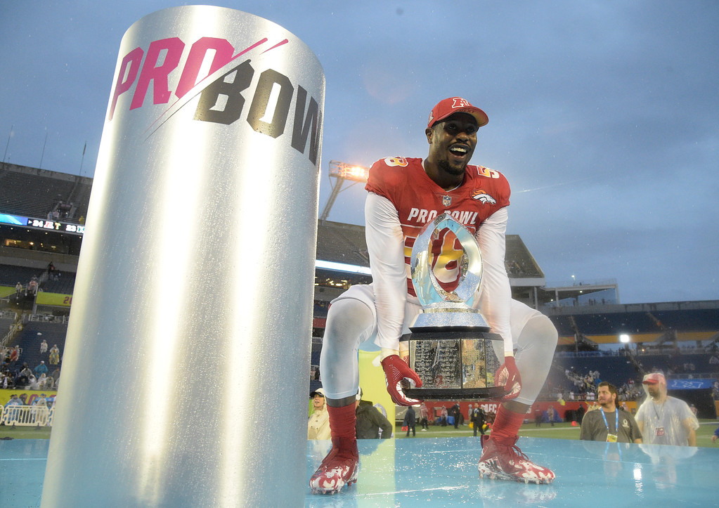 . AFC linebacker Von Miller (58), of the Denver Broncos, raises the Pro Bowl trophy after defeating the AFC 24-23, Sunday, Jan. 28, 2018, in Orlando, Fla. Miller won the MVP for the Defensive Player of the Game. (AP Photo/Phelan M. Ebenhack)