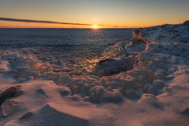 Sunset at the frozen Gulf of Finland