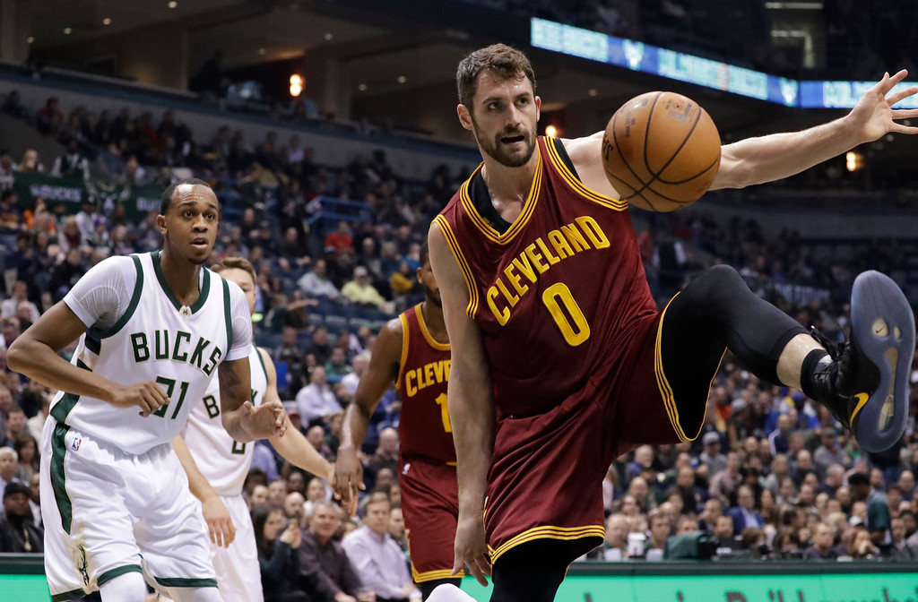 . Cleveland Cavaliers\' Kevin Love is fouled driving to the basket during the first half of an NBA basketball game against the Milwaukee Bucks Tuesday, Nov. 29, 2016, in Milwaukee. (AP Photo/Morry Gash)
