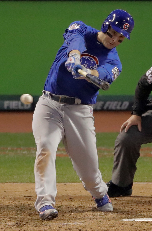 . Chicago Cubs\' Anthony Rizzo hits a RBI single against the Cleveland Indians during the fifth inning of Game 7 of the Major League Baseball World Series Wednesday, Nov. 2, 2016, in Cleveland. (AP Photo/Charlie Riedel)
