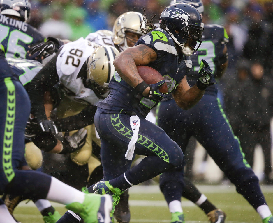 . Seattle Seahawks running back Marshawn Lynch runs against the New Orleans Saints during the second quarter of an NFC divisional playoff NFL football game in Seattle, Saturday, Jan. 11, 2014. (AP Photo/John Froschauer)