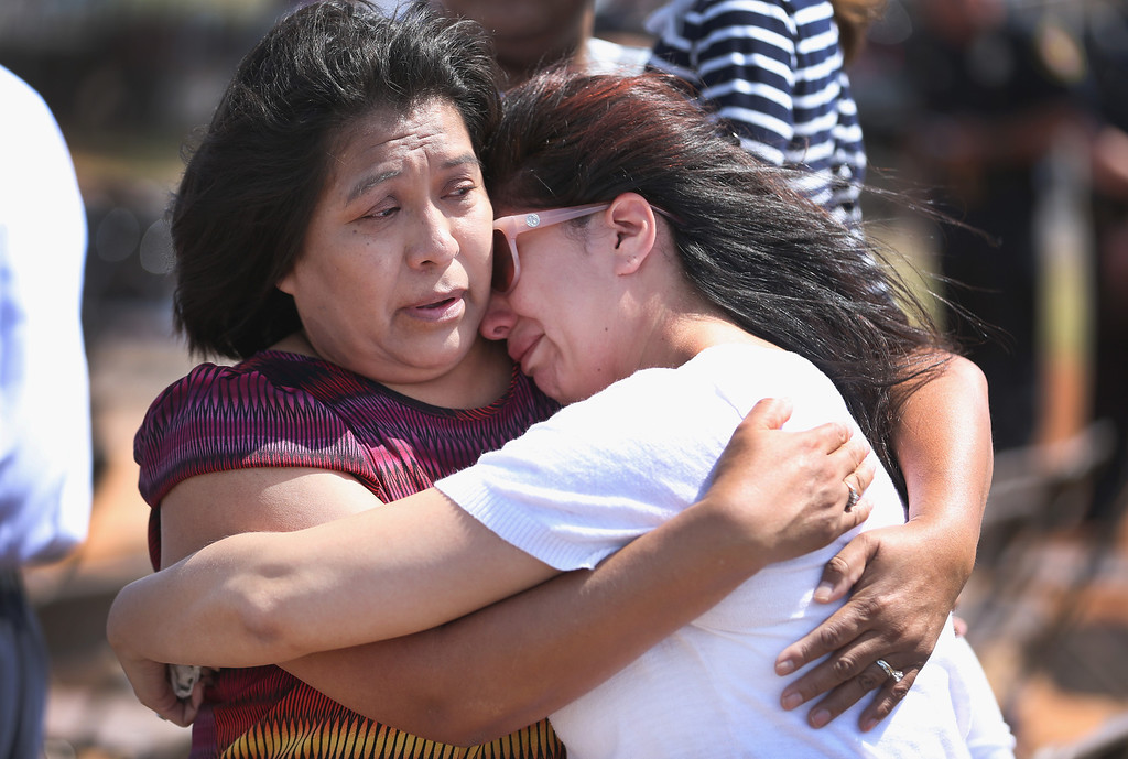 . During a remembrance ceremony on the grounds of what once was the Moore Medical Center, Rosita Begay (L) hugs her daughter Amber McQuerry as they remember her mother-in-law Kathryn Begay who was killed during a tornado on May 20, 2014 in Moore, Oklahoma.  A two-mile wide EF5 tornado touched down in the town on May 20, 2013, killing 24 people and leaving behind extensive damage to homes and businesses.  (Photo by Joe Raedle/Getty Images)