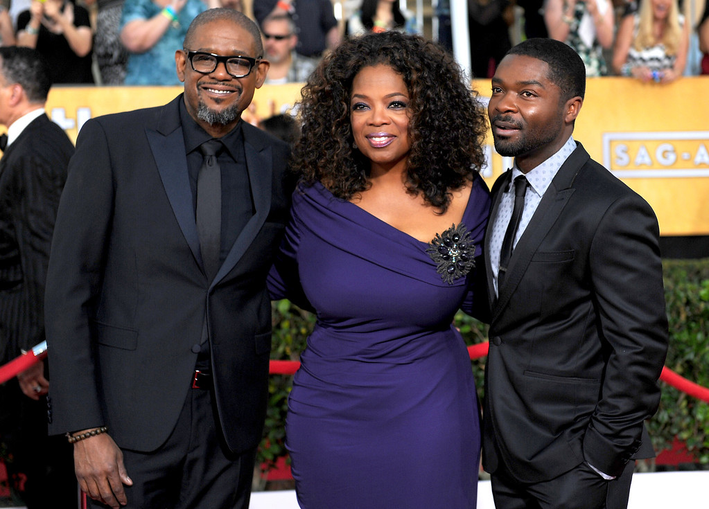 . Forest Whitaker and Oprah Winfrey arrives at the 20th Annual Screen Actors Guild Awards  at the Shrine Auditorium in Los Angeles, California on Saturday January 18, 2014 (Photo by Michael Owen Baker / Los Angeles Daily News)