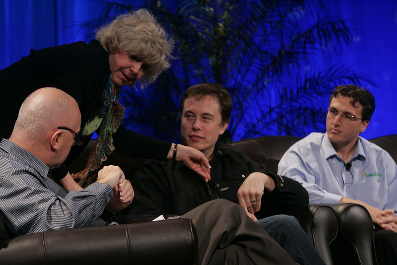 """""""Earth on FiRe: Rapid Response to Climate Crisis"""": (L-R) Moderator Steve Evans, BBC World Service; Jean Wooldridge making a mic adjustment; Elon Musk, CEO and CTO, SpaceX; and Lyndon Rive, CEO, SolarCity"""