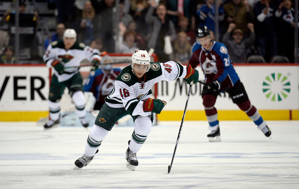 . Jared Spurgeon (46) of the Minnesota Wild chases the puck down ice during the first period of action. The Colorado Avalanche hosted the Minnesota Wild in the first round of the Stanley Cup Playoffs at the Pepsi Center in Denver, Colorado on Saturday, April 19, 2014. (Photo by John Leyba/The Denver Post)