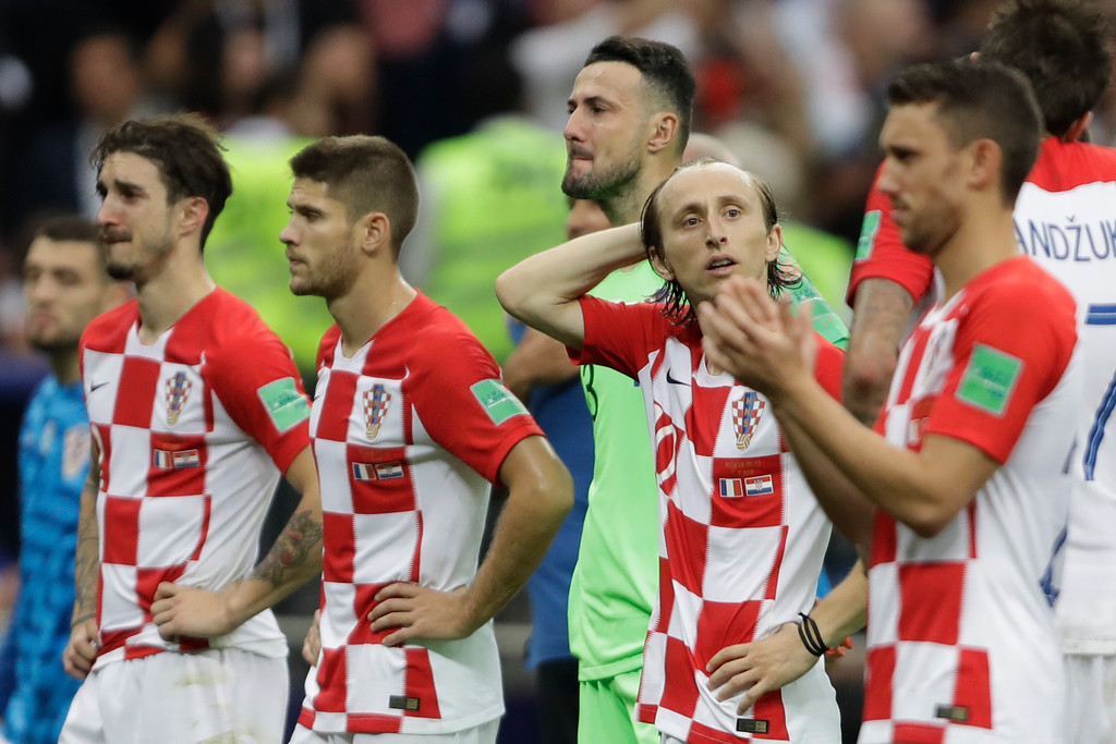 . Croatia\'s Luka Modric and teammates at the end of the final match between France and Croatia at the 2018 soccer World Cup in the Luzhniki Stadium in Moscow, Russia, Sunday, July 15, 2018. (AP Photo/Natacha Pisarenko)