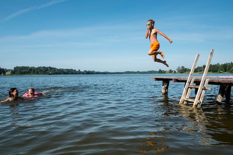 Family enjoying summer by the lake, Giby, Poland