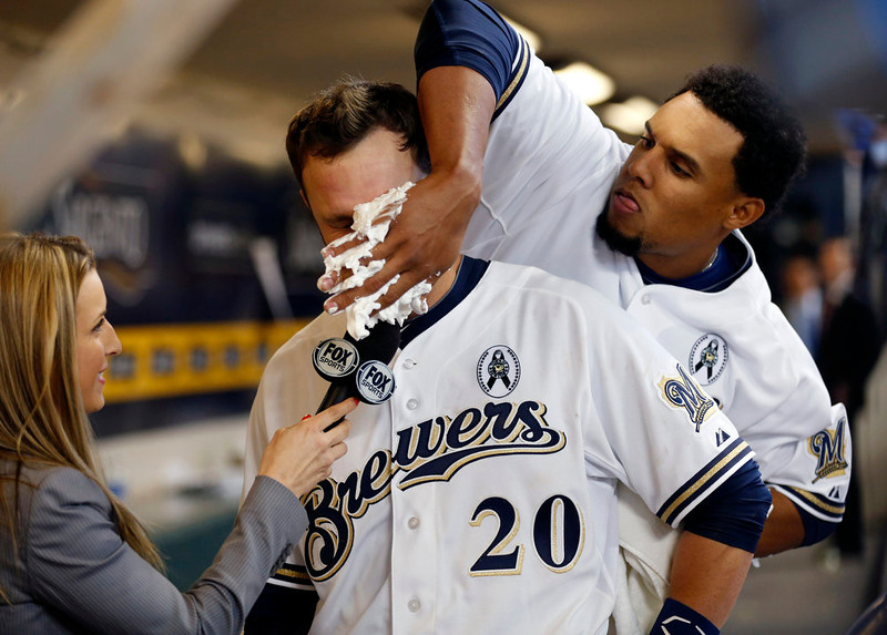 . Milwaukee Brewers\' Jonathan Lucroy (20) gets a pie in the face from teammate Carlos Gomez during a post-game interview after an opening day baseball game against the Colorado Rockies. Monday, April 1, 2013, in Milwaukee. Lucroy hit the game-winning sacrifice fly in the eleventh inning. The Brewers won 5-4. (AP Photo/Jeffrey Phelps)