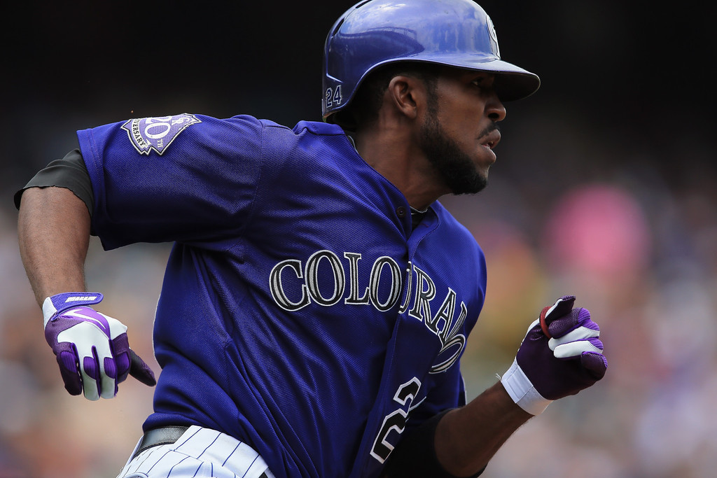 . Dexter Fowler #24 of the Colorado Rockies doubles to lead off the first inning against starting pitcher Ross Detwiler #48 of the Washington Nationals at Coors Field on June 13, 2013 in Denver, Colorado.  (Photo by Doug Pensinger/Getty Images)