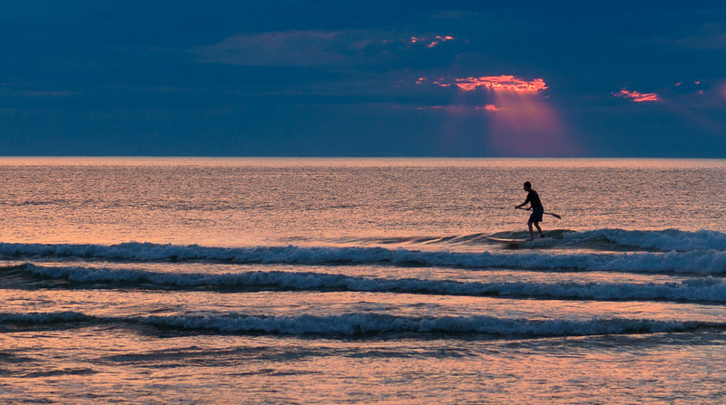 Paddle Boarder in the Early Morning