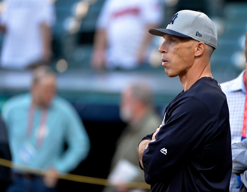 . New York Yankees manager Joe Girardi watches batting practice before Game 1 of baseball\'s American League Division Series against the Cleveland Indians, Thursday, Oct. 5, 2017, in Cleveland. (AP Photo/Phil Long)