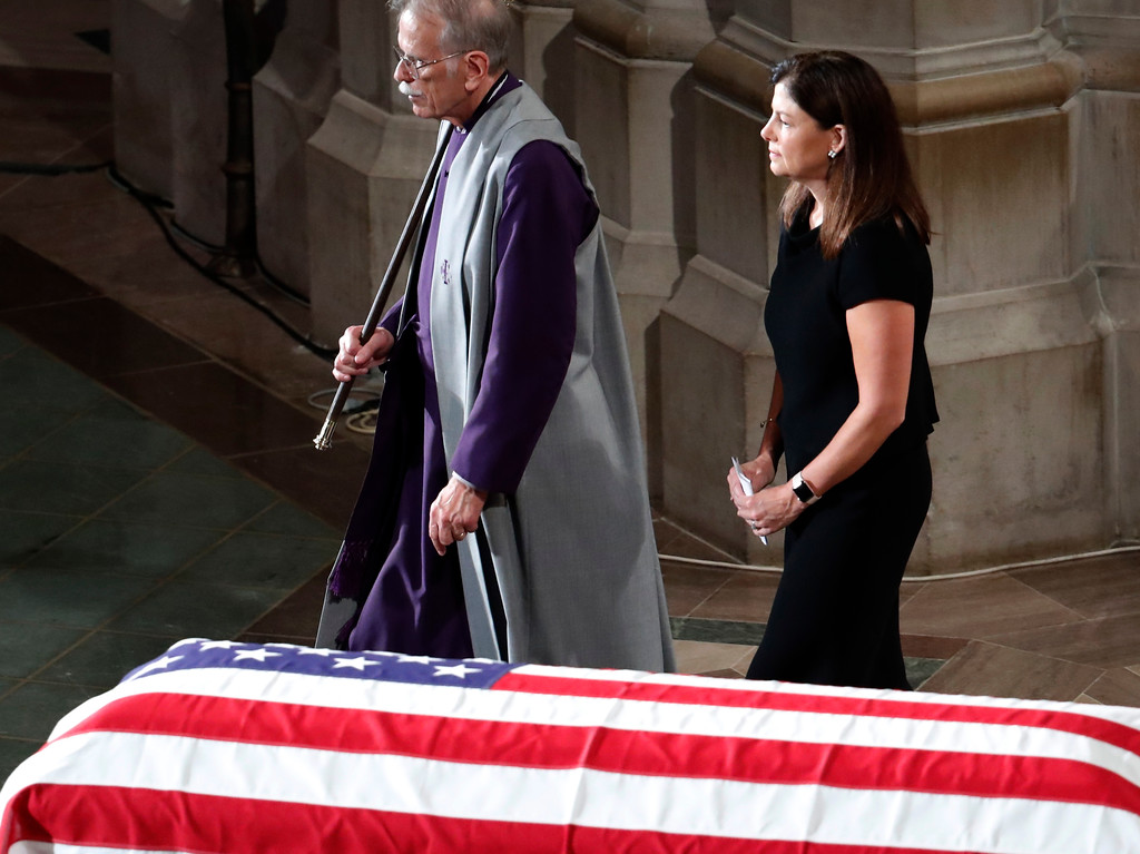 . Former New Hampshire Sen. Kelly Ayotte walks after reading scripture at a memorial service for Sen. John McCain, R-Ariz., at Washington National Cathedral in Washington, Saturday, Sept. 1, 2018. McCain died Aug. 25, from brain cancer at age 81. (AP Photo/Pablo Martinez Monsivais)