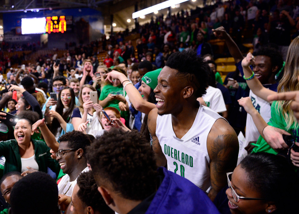 . De\'ron Davis (20) of Overland Trailblazers celebrates in the crowd after defeating Eaglecrest Raptors at the Coors Events Center on March 12, 2016 in Boulder, Colorado. Overland Trailblazers defeated Eaglecrest Raptors 66-56 to win the Colorado State 5A Basketball Championship.  (Photo by Brent Lewis/The Denver Post)