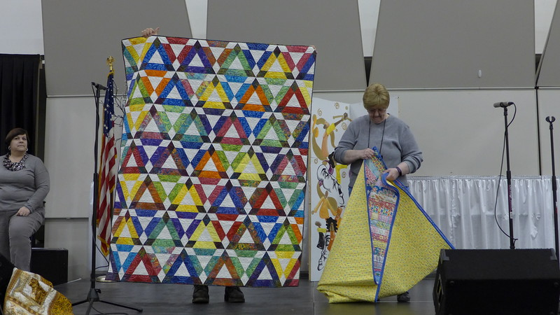 Nancy Boyse presented these two quilts that were made from fabrics purchased at Paducah several years ago.